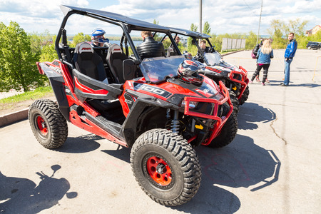 maneuverability: Samara, Russia - May 13, 2017: Red atv quad bikes parked at the city street in summer day