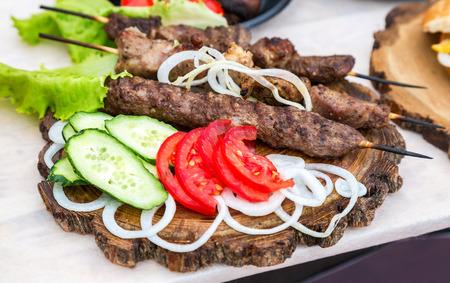vegetarian hamburger: Grilled shish kebab or shashlik on wooden skewers with fresh vegetables