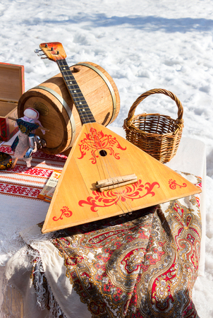 Balalaika and other products of Russian folk art over the snow background Stock Photo