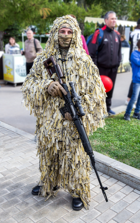 Samara, Russia - September 10, 2017: Unidentified Russian soldier with sniper rifle in hand at the  street during the city festival Editorial
