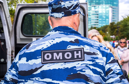 Samara, Russia - September 10, 2017: Russian police officer in uniform of Special Purpose Mobile Unit (OMON). Russian SWAT. Text in russian: OMON Editorial