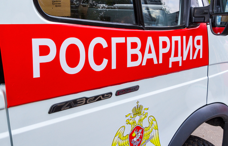 Samara, Russia - September 10, 2017: Inscription Rosgvardia and emblem of the troops of the National Guard of the Russian Federation on the board of car. Text in russian: Rosgvardia Editorial