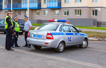 squad: Samara, Russia - September 17, 2017: Russian police patrol cars of the State Automobile Inspectorate on the city street in summer day Editorial