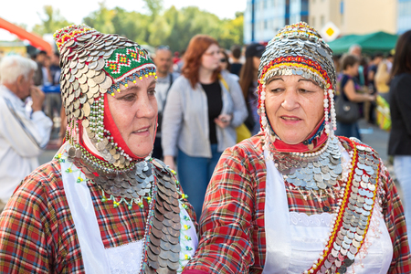Samara, Russia - September 17, 2017: Two unidentified womans in the Chuvash national headdress during the folklor festival Stok Fotoğraf - 86342685
