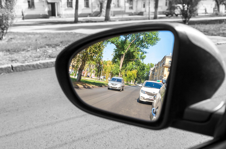 Samara, Russia - September 5, 2017: Reflection in the rearview mirror of a car in summer sunny day
