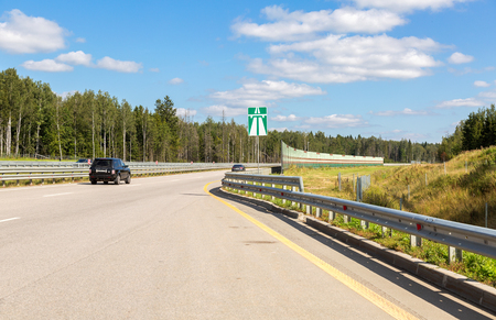 turnpike: Moscow, Russia - August 08, 2017: Toll road. Russian highway number M11 in summer day