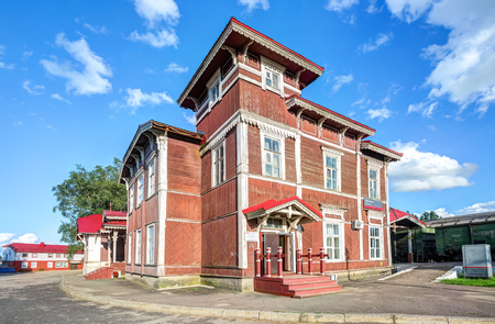 Borovichi, Russia - August 13, 2017: Old wooden provincial railway station with platform in summer sunny day. Novgorod region, Russia Editorial