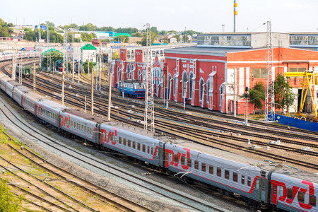 complicated journey: Samara, Russia - September 16, 2017: View on the railway track with train and railway depot at the Samara railway station in summer day Editorial