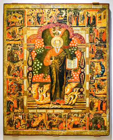 Veliky Novgorod, Russia - August 17, 2017: Antique Russian orthodox icon. St. John the Theologian with Scenes from his Life painted on old wooden board, 17-th century Editorial