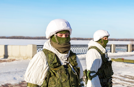 Samara, Russia - January 27, 2018: Unidentified Russian soldiers in modern military winter uniform at the street during the city festival. Military, war, conflict, soldiers concept