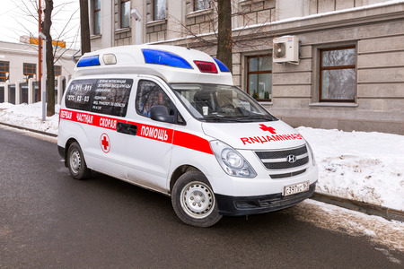 Samara, Russia - February 18, 2018: Ambulance car parked up in the street. Text in russian: The first private ambulance
