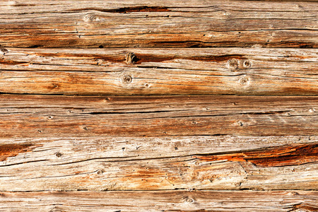 Wooden logs wall of old rural house as background texture Stock Photo