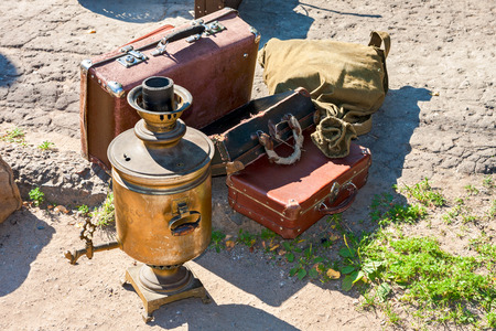 Vintage travel luggage with old suitcases and copper samovar in sunny day  Stock Photo