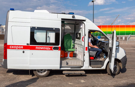 Samara, Russia - May 16, 2018: Ambulance car parked up near the Samara Arena football stadium. Text in russian: The ambulance Editorial
