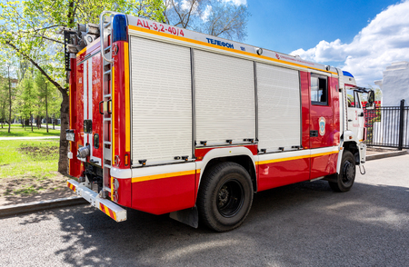 Samara, Russia - May 9, 2018: Red fire truck EMERCOM of Russia and rescue vehicle parked up on the street in summer day