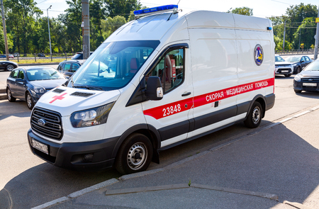 Saint Petersburg, Russia - August 10, 2018: Ambulance car parked up in the street. Text in russian: Emergency Medicine