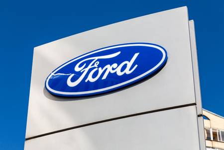 Saint Petersburg, Russia - August 10, 2018: Ford dealership sign against a blue sky Sajtókép