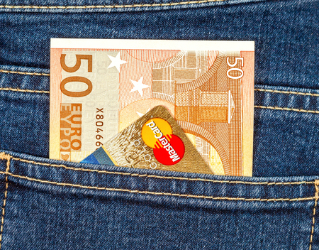 Samara, Russia - November 24, 2017: Banknote 50 euro and Mastercard sticking out of the back jeans pocket Editorial