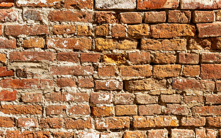 Background of old weathered red brick wall. Bricks masonry as texture