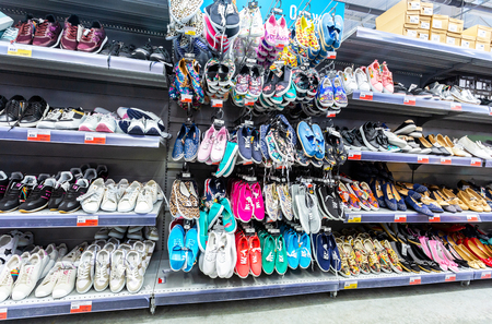 Samara, Russia - March 24, 2018: Different shoes ready to sale at showcase in the chain hypermarket