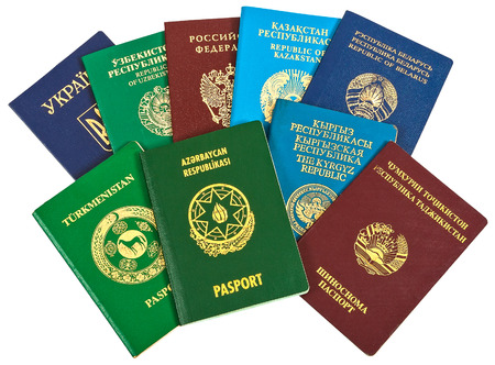 Different foreign passports for travel and tourism isolated on white background