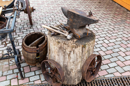 Vintage rusty anvil with blacksmith tools for iron work Stock Photo