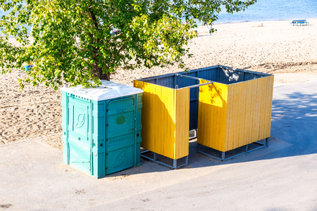 Samara, Russia - September 22, 2018: Beach changing room and mobile public toilet at the city beach on the shores of the Volga river Editorial
