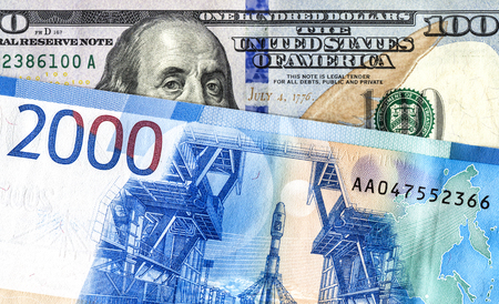 American 100 dollar banknote and 2000 russian roubles. Concept trade, cooperation or wrestling