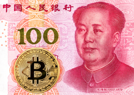 Cryptocurrency Bitcoin lying on the Chinese 100 yuan banknote. Business concept of worldwide digital money Фото со стока