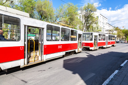Samara, Russia - May 14, 2018: Russian public transport. Tram runs on the city street in summer sunny day