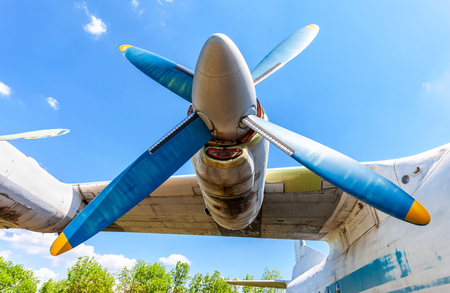 Turbine of old soviet turboprop aircraft against the blue sky Editorial