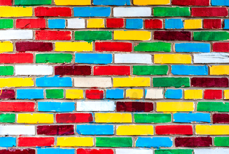 Colored brick wall from multicolored bricks as a creative background