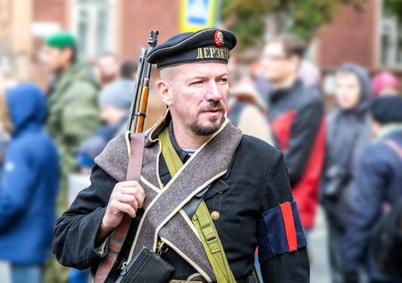 Samara, Russia - October 6, 2018: Unidentified member of historical reenactment battle in navy uniform during the Russian Civil War in 1918 Redakční