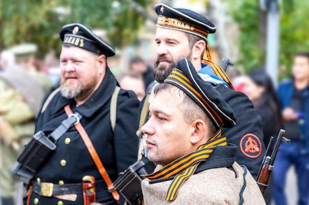 Samara, Russia - October 6, 2018: Unidentified members of historical reenactment battle in navy uniform during the Russian Civil War in 1918