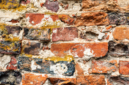 Grunge red brick wall as background texture. Bricks masonry Banco de Imagens