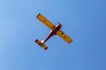 Samara region, Russia - April 13, 2019: Simple Polish plane Wilga 35 flying in the blue sky