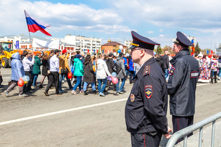 Samara, Russia - May 1, 2019: Unidentified Russian policemans in uniform watching the rule of law during the demonstration on labor day. Text in Russian: Police