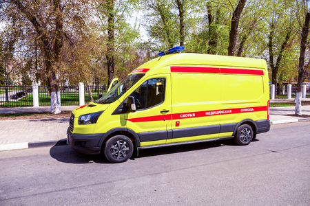 Samara, Russia - May 1, 2019: Ambulance car parked up on the city street. Text in russian: Emergency Medicine