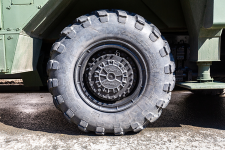 Samara, Russia - May 4, 2019: Close up view of heavy truck army vehicle wheel with Belshina tire
