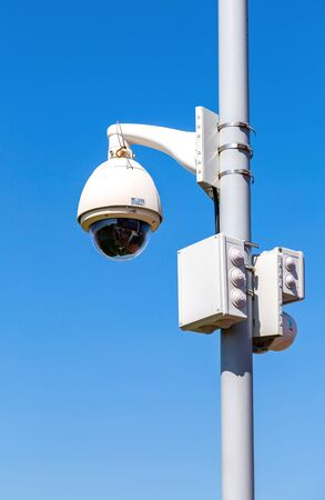 Samara, Russia - May 10, 2019: Surveillance CCTV cameras mounted on post against the blue sky
