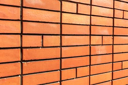 Red brick wall as background texture. Bricks masonry with seams Stock Photo