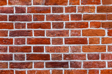 Vintage red brick wall as background texture. Bricks masonry with seams Stock Photo - 124437903