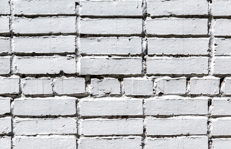 White brick wall as background texture. Bricks masonry with seams