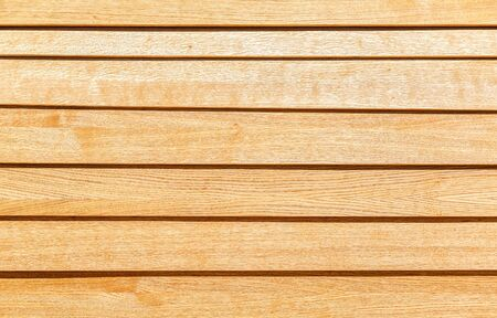 Wooden planks with natural patterns as background, wooden board texture. Boardwalk wooden background