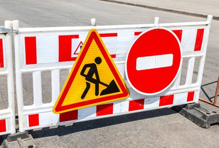 Road works traffic sign at the city street, stop sign