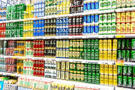 Samara, Russia - June 9, 2019: Low alcoholic beverages. Different beer cans with cool fresh beer ready for sale in supermarket
