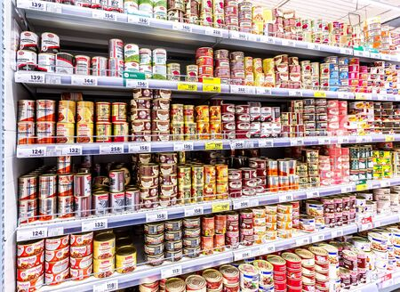 Samara, Russia - June 9, 2019: Various canned meat in cans for sale on the shelves at the chain hypermarket