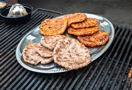 Appetizing pieces of grilled meat cooked on the grill over the hot charcoals