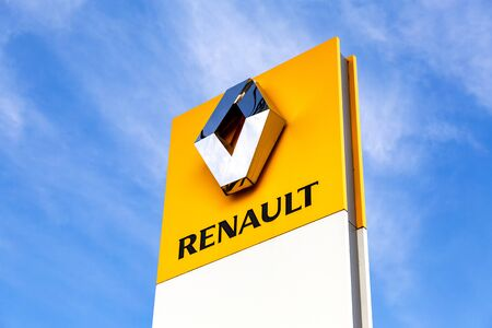 Veliky Novgorod, Russia - August 23, 2019: Renault dealership sign against the blue sky. Renault is a French multinational vehicle manufacturer
