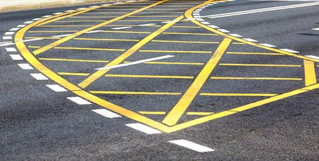 White and yellow road lines on the city street